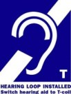 A hearing assistance sign with a 'T' lets people know they can activate their telecoil, or t-coil.